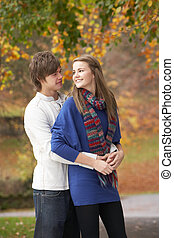Romantic Teenage Couple In Autumn Park