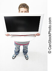 Portrait of Smiling Teenage Boy Holding Television