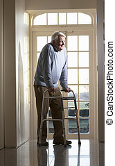 Elderly Senior Man Using Walking Frame