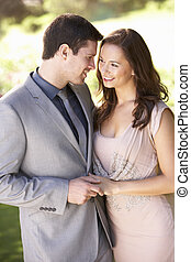 Smartly Dressed Young couple in park