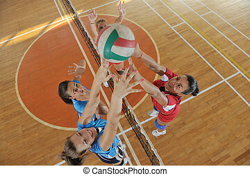girls playing volleyball indoor game - volleyball game sport...