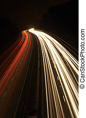 Headlights And Tail Lights On A Motorway At Night