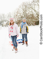 Children Pulling Sledge Through Snowy Landscape