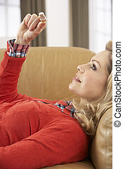Woman Looking At Result Of Home Pregnancy Test Kit