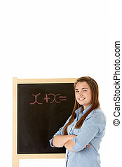Female Student Standing Next To Blackboard
