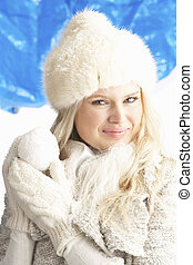 Young Woman Wearing Warm Winter Clothes And Fur Hat Holding...