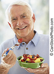 Senior Man Eating Fresh Fruit Salad