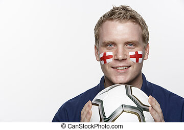 Young Male Football Fan With St Georges Flag Painted On Face