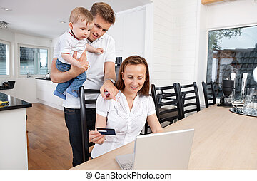 Online shopping - Family shopping online at home