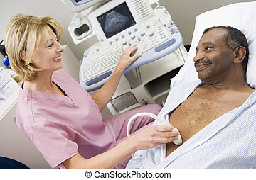 Nurse Giving Patient An Ultra Sound