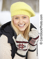 Close Up Of Teenage Girl In Snowy Landscape