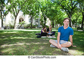 Group of students at college campus - Group of students...