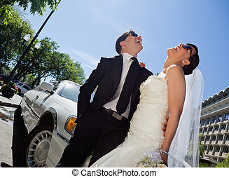 Wedding Couple Laugh - Happy newly wed couple in sunglasses