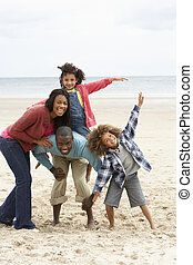 Happy family playing on beach