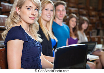 Students in Lecture Hall - Group of students sitting in a...