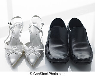 Bride And Groom's Shoes Side By Side