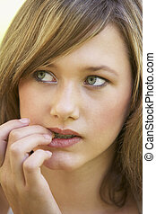 Portrait Of Teenage Girl Biting Nails