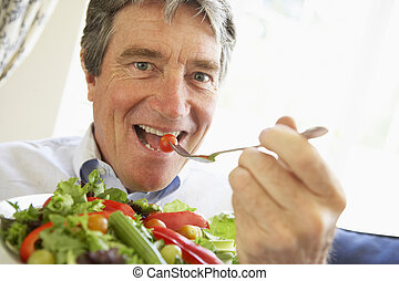 Senior Man Eating Salad