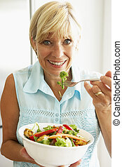 Middle Aged Woman Eating A Healthy Salad
