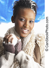 Young Woman Wearing Warm Winter Clothes Holding Snowball In...