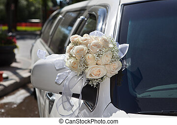 Wedding Bouquet on Limo - Wedding car decorated with flower...