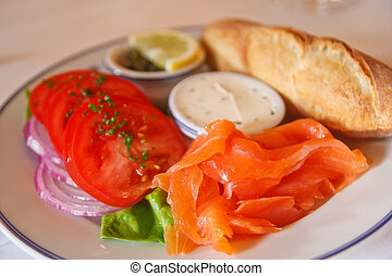Smoked Salmon Platter with Tomatoes and Bread - A breakfast...
