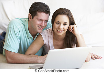 Young couple on laptop computer