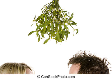 Couple standing under mistletoe - Detail of couple standing...