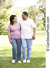 Senior Couple Walking In Park