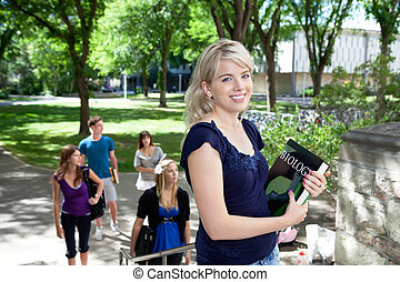 Students going to college - Portrait of sweet young girl...