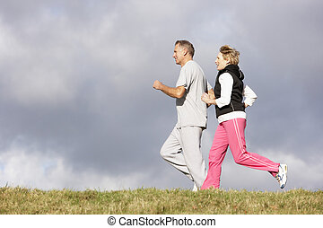 Senior Couple Jogging In The Park