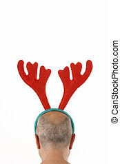 Man Wearing Reindeer Antlers Against White Background