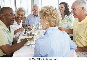 Friends Having Lunch Together At A Restaurant