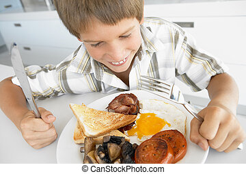 Young Boy Eating Unhealthy Fried Breakfast