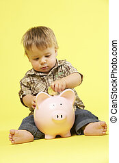 Toddler In Studio With Piggy Bank
