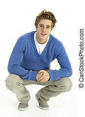 Young Man Crouching In Studio