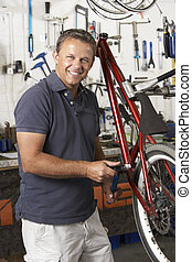 Owner of cycle shop in workshop