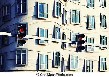 traffic lights - Asymmetrical curves and rows of windows and...