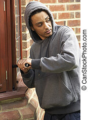 Young Man Breaking Into House