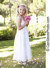 Portrait Of Bridesmaid Holding Bouquet Outdoors
