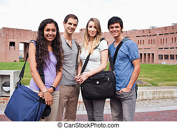 Fellow students posing outside a building