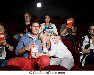 Young couple at cinema