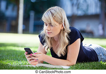 Young girl using cell phone - Young college girl using cell...