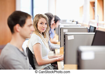 Fellow students using a computer in an OT room