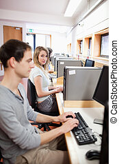 Portrait of a fellow students using a computer in an IT room