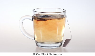 Tea in bag - A tea bag in glass cup boiling water....