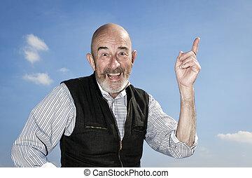 old man - An old man with a grey beard is having an idea
