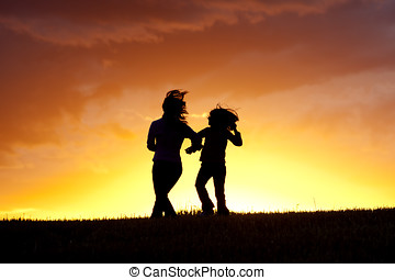 Dancing a jig at sunset - A mother and her daughter do a...