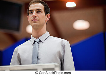 Young man doing a presentation looking away from the camera