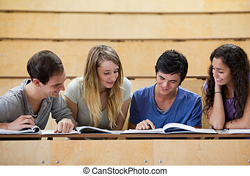 Students working together in an amphitheater